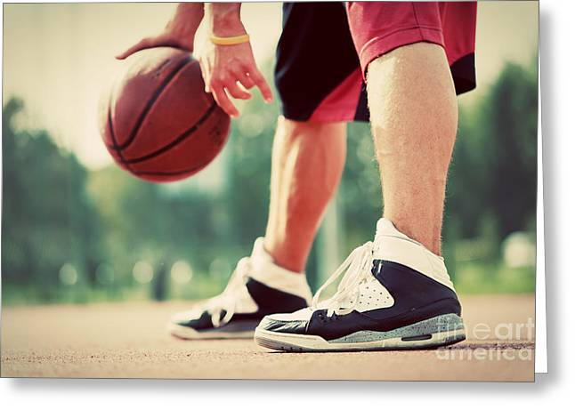 Young Man On Basketball Court Dribbling With Bal Greeting Card by Michal Bednarek