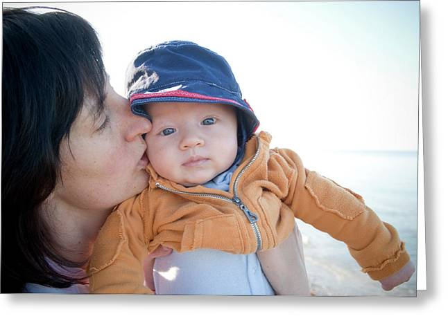 Young Mother Kissing Babys Cheek While Greeting Card