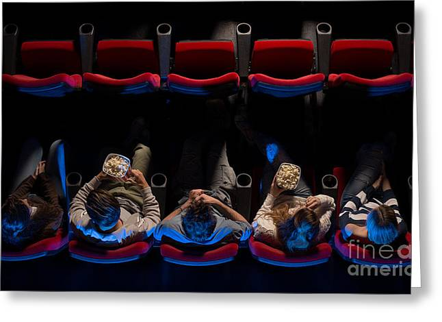 Young People Sitting At The Cinema Greeting Card by Stock-asso