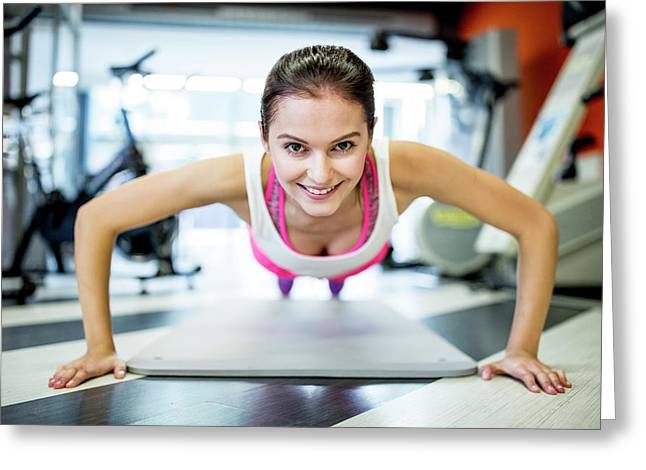 Young Woman Doing Press-ups Greeting Card by Science Photo Library