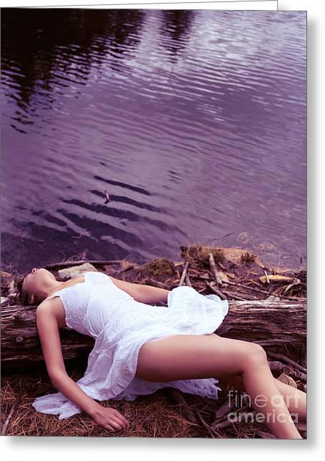 Young Woman In White Dress Lying Near Lake Greeting Card