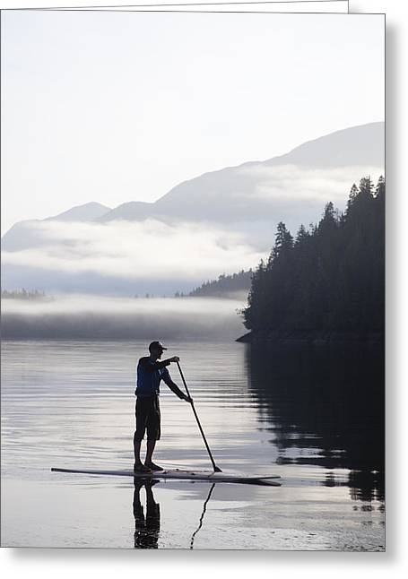 A Man Standup Paddleboards Across An Greeting Card by Taylor S. Kennedy