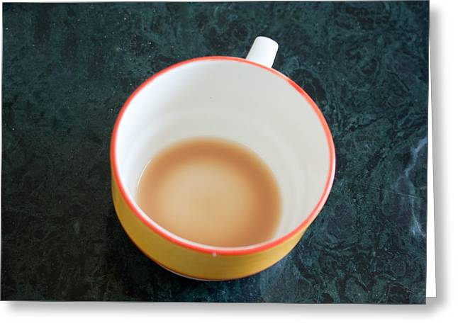 A Cup With The Remains Of Tea On A Green Table Greeting Card by Ashish Agarwal