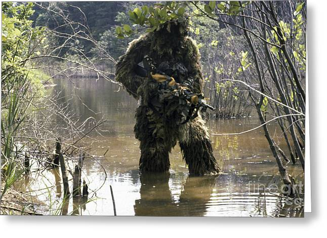 A Sniper Dressed In A Ghillie Suit Greeting Card by Stocktrek Images