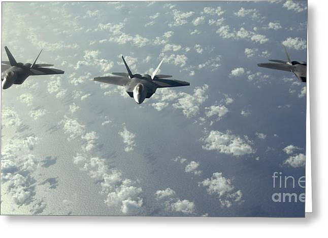 A Three-ship Formation Of F-22 Raptors Greeting Card by Stocktrek Images