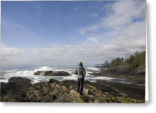 A Woman Stands On A Rocky Outcropping Greeting Card by Taylor S. Kennedy