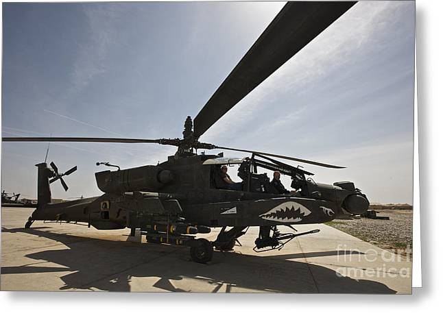 An Ah-64d Apache Helicopter Parked Greeting Card