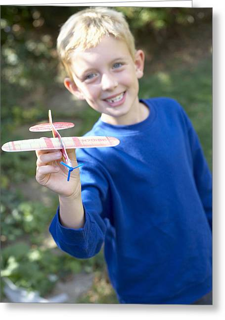 Boy Playing With A Toy Aeroplane Greeting Card by Ian Boddy