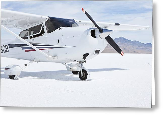 Cessna Aircraft On Bonneville Salt Flats Greeting Card by Paul Edmondson