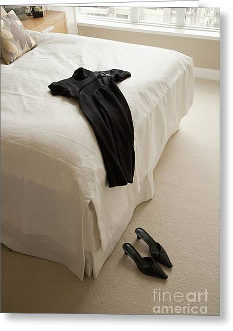 Dress Lying On Bed Greeting Card