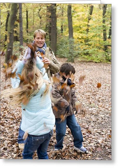 Father And Children Playing In A Wood Greeting Card
