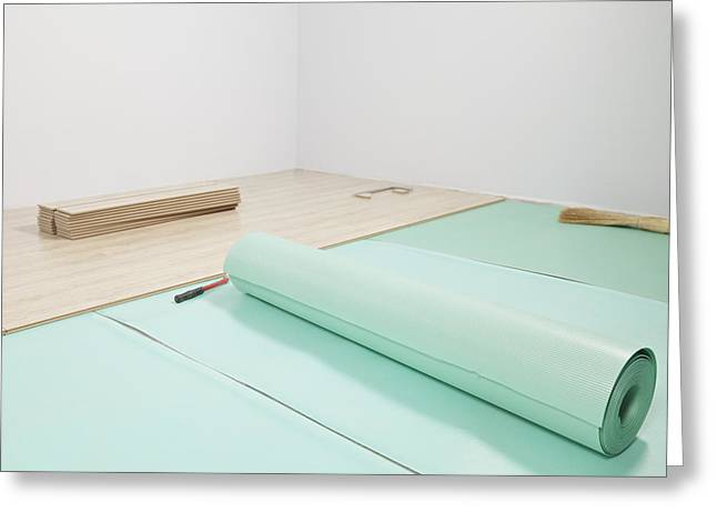 Laying A Floor. Rolls Of Underlay Or Greeting Card