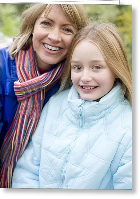 Mother And Daughter Outdoors In Winter Greeting Card by Ian Boddy