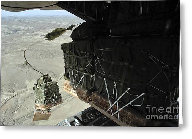 Pallets Roll Out Of A C-130 Hercules Greeting Card by Stocktrek Images