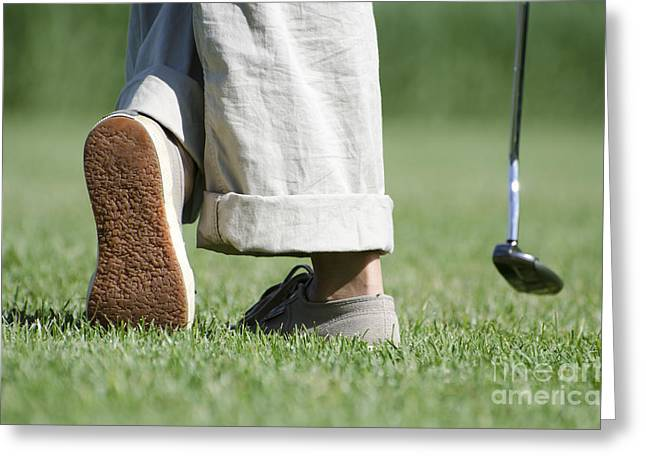 Playing Golf Greeting Card by Mats Silvan