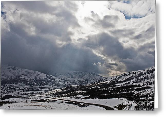 Road Through A Snowy Mountain Landscape Greeting Card by Thom Gourley/Flatbread Images, LLC