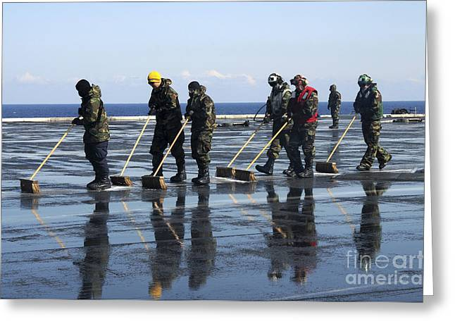 Sailors Scrub The Flight Deck Aboard Greeting Card by Stocktrek Images