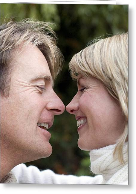 Smiling Couple Embracing Greeting Card