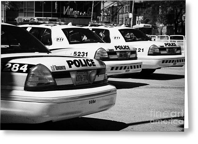 Toronto Police Squad Cars Outside Police Station In Downtown Toronto Ontario Canada Greeting Card by Joe Fox