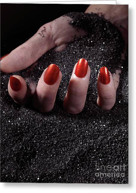 Woman Hand With Red Nails On Black Sand Greeting Card by Oleksiy Maksymenko