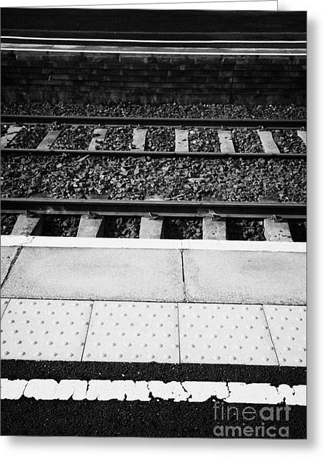 Yellow Warning Line And Textured Contoured Tiles Railway Station Platform And Track Northern Ireland Greeting Card by Joe Fox