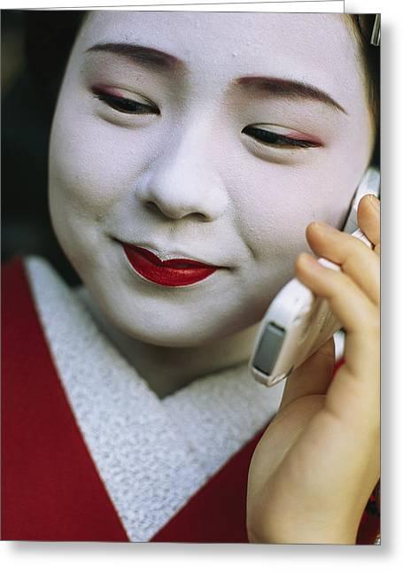 A Kimono-clad Geisha Talks On A Cell Greeting Card
