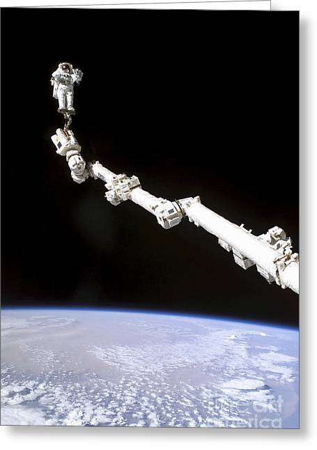 Astronaut Anchored To A Foot Restraint Greeting Card by Stocktrek Images