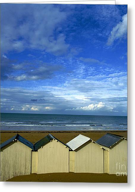 Beach Huts Under A Stormy Sky In Normandy Greeting Card by Bernard Jaubert