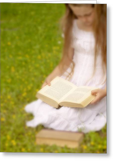 Girl Is Reading A Book Greeting Card by Joana Kruse