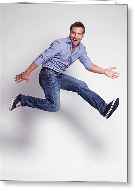 Jumping Young Man Greeting Card by Oleksiy Maksymenko