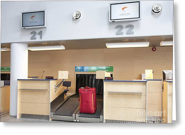 Luggage At An Airline Check-in Counter Greeting Card by Jaak Nilson