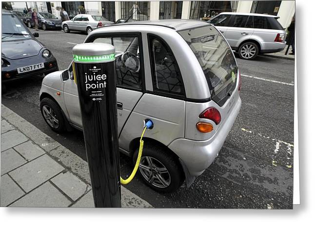 Recharging An Electric Car Greeting Card by Martin Bond