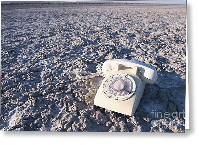 White Telephone On Dried Mud Greeting Card by Thom Gourley/Flatbread Images, LLC