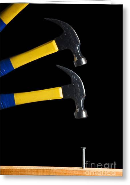 Hammer Striking A Nail Greeting Card by Ted Kinsman