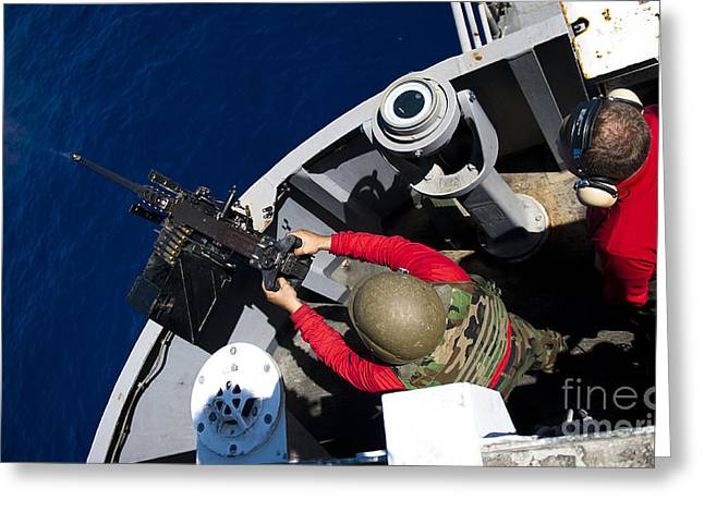 A Sailor Fires A .50-caliber Machine Greeting Card by Stocktrek Images
