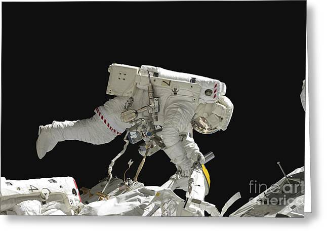 Astronaut Working On The International Greeting Card by Stocktrek Images