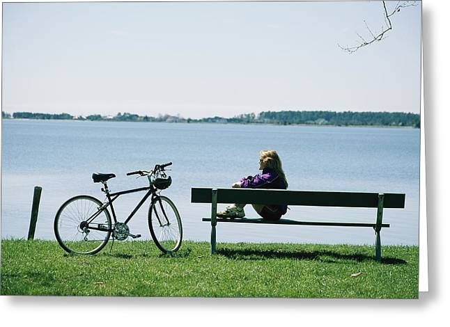 A Biker Rests On A Bench Near Marylands Greeting Card