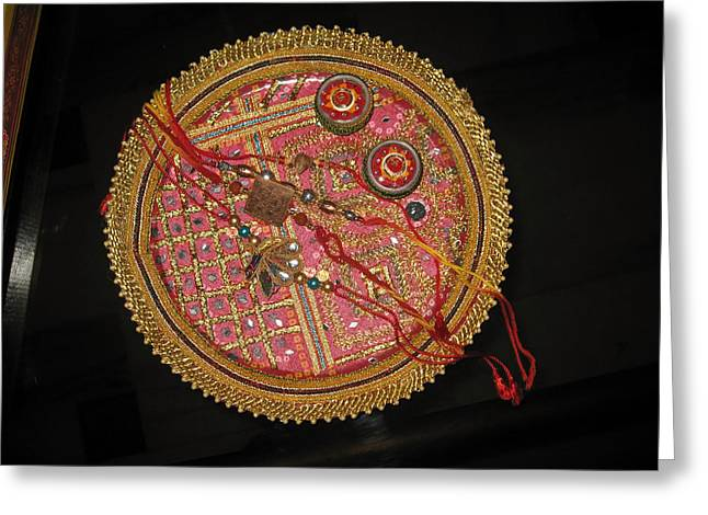Greeting Card featuring the photograph A Bowl Of Rakhis In A Decorated Dish by Ashish Agarwal