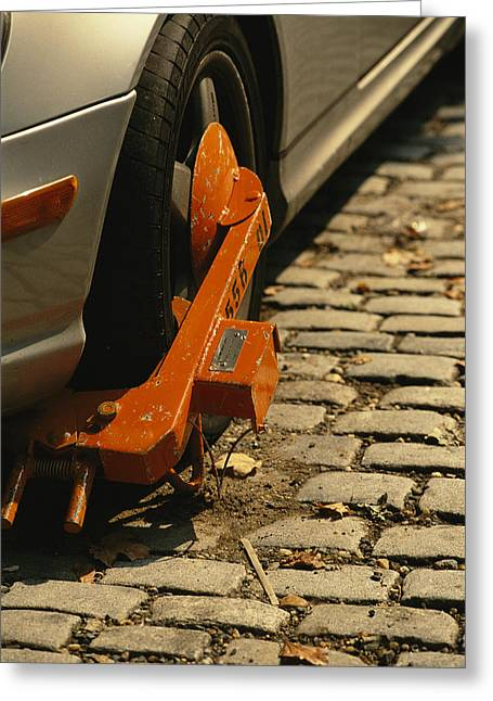 A Car With A Booted Tire Greeting Card by Richard Nowitz