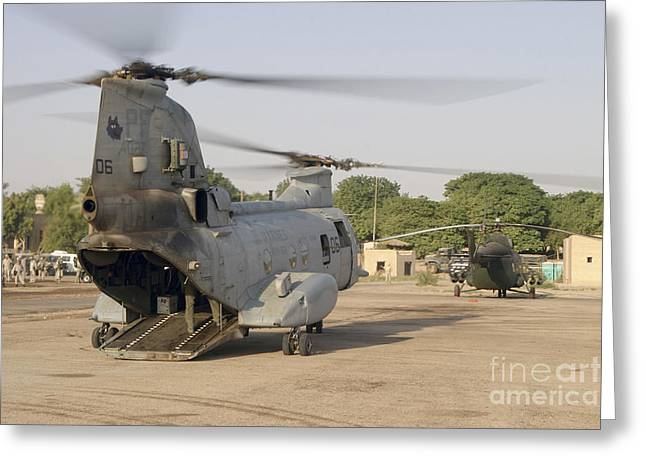A Ch-46 Sea Knight And Mi-8 Helicopter Greeting Card by Stocktrek Images