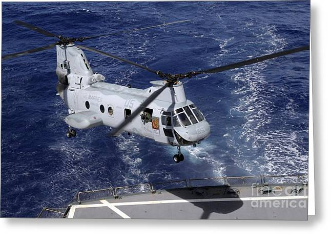 A Ch-46 Sea Knight Helicopter Lands Greeting Card by Stocktrek Images