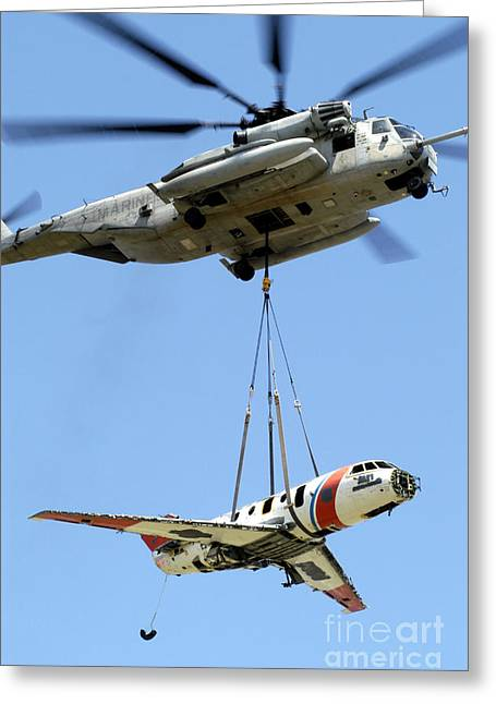 A Ch-53 Sea Stallion Lifts A Hu-25 Greeting Card by Stocktrek Images