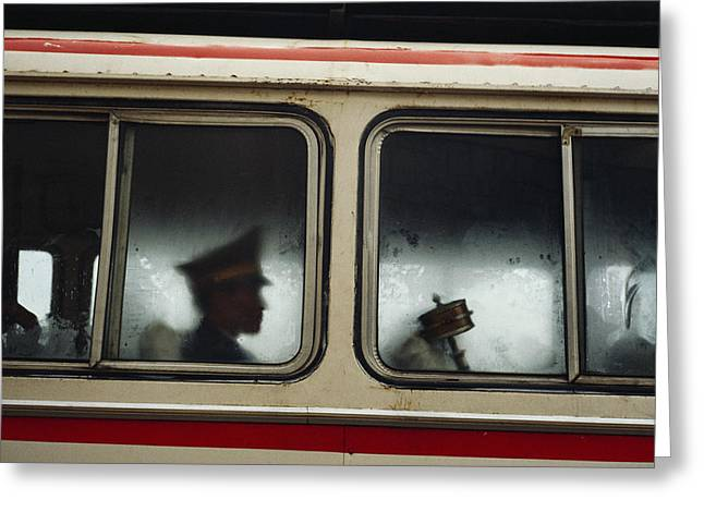 A Chinese Pla Soldier Sits On A Bus Greeting Card by Justin Guariglia