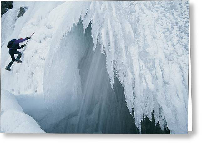 A Climber Scales An Ice Formation Greeting Card