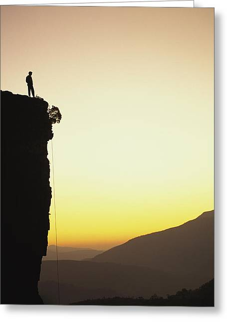 A Climber Stands Atop A Cliff Greeting Card