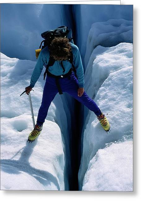 A Climber Steps Over A Crevasse In Root Greeting Card by Rich Reid