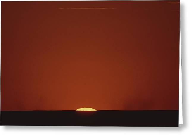 A Contrast Shot Of Red Sky And Dark Greeting Card by Kenneth Garrett
