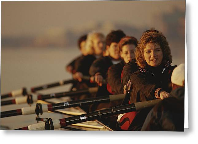 A Crew Team Paddles In Unison Greeting Card by Sam Kittner