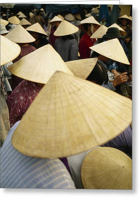A Crowd Of People In Conical Straw Hats Greeting Card by Justin Guariglia