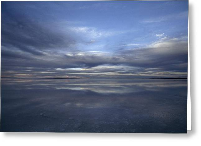 A Fading Sunset Reflects Off The Still Greeting Card by Jason Edwards